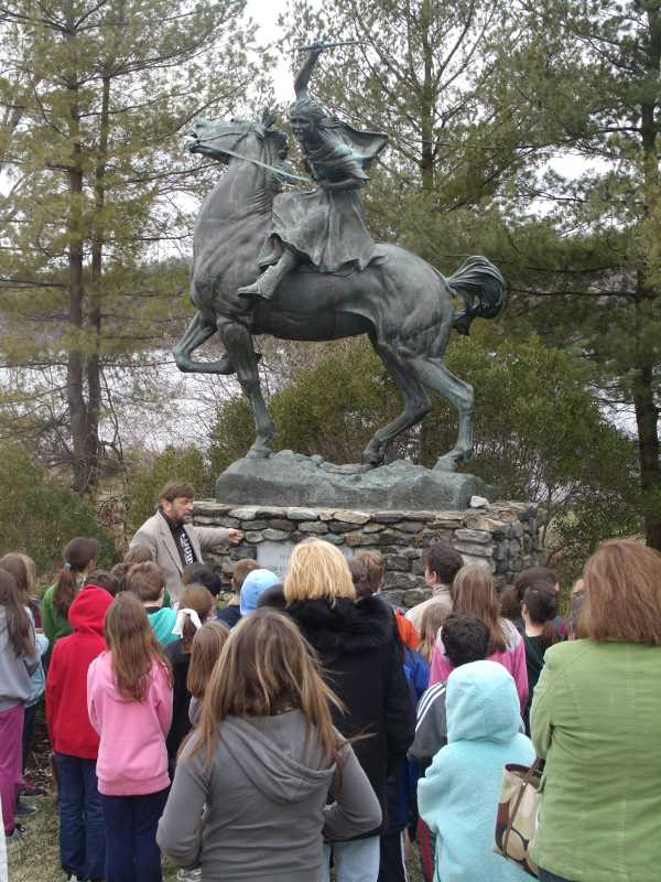 Vin conducts tour with fourth graders at Sybil's statue